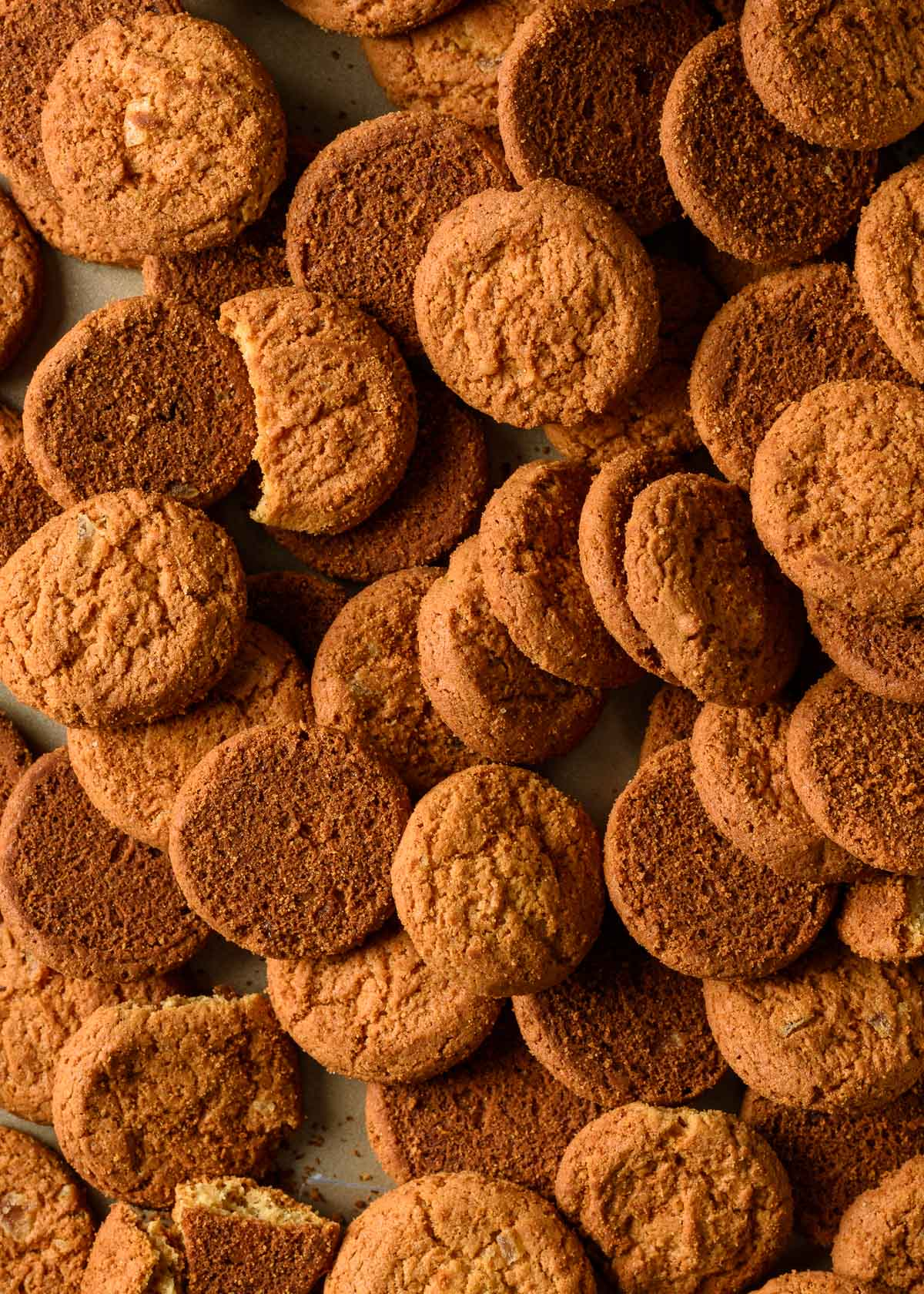 a close up of gingersnap cookies on a baking sheet