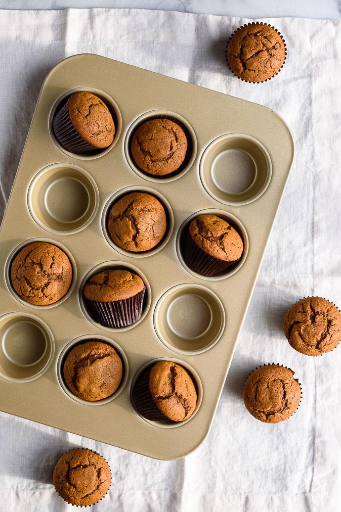 gingerbread muffins in a muffin tin