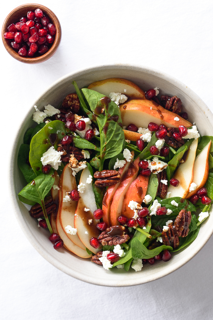 Spinach and Pear Salad with Goat Cheese, Pomegranate, and Candied Pecans via forkknifeswoon.com