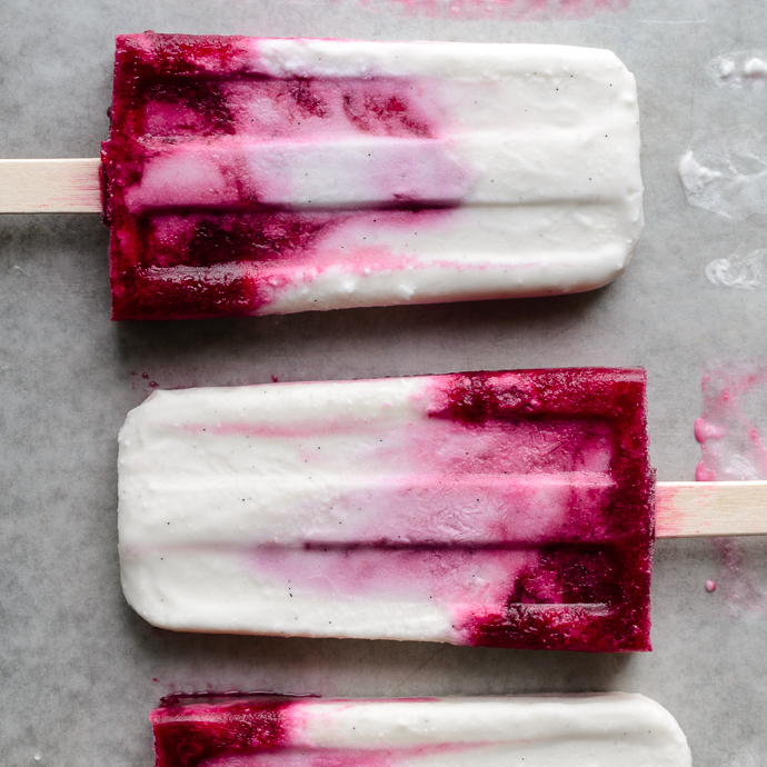 Creamy Coconut and Mixed Berry Popsicles. These refined-sugar free, vegan-optional ice pops are made with wholesome ingredients and are super easy to whip up. via forkknifeswoon.com