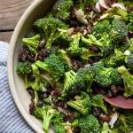 Fresh and healthy Broccoli Salad with Raisins, Almonds, and a Lemon Tahini Dressing via forkknifeswoon.com