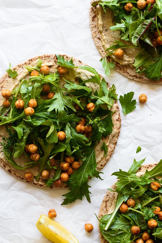 Pita Flatbreads with Hummus, Spring Greens, Crispy Chickpeas and an Herb Yogurt Sauce | via forkknifeswoon.com
