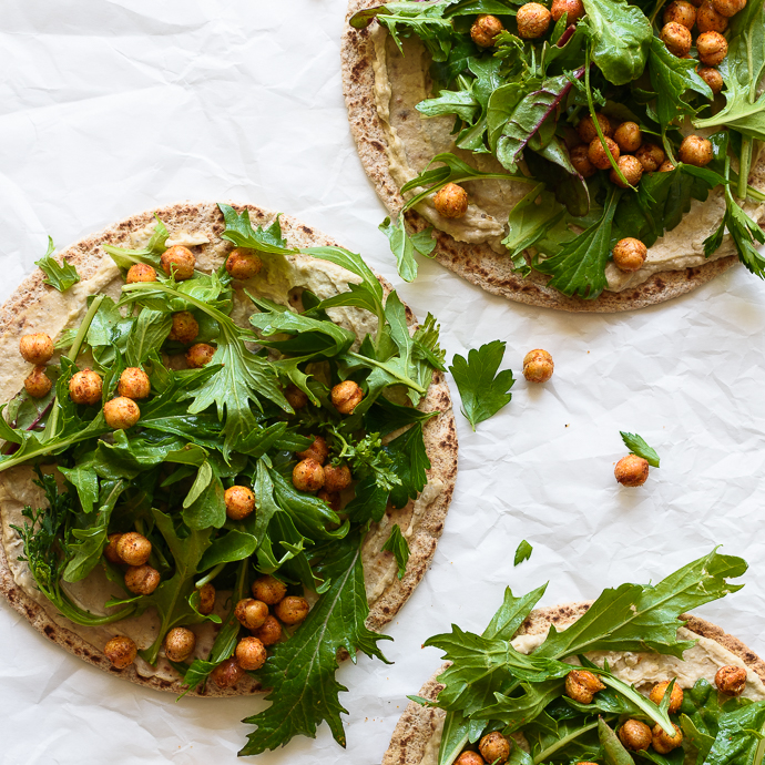 Pita Flatbreads with Hummus, Spring Greens, Crispy Chickpeas and an Herb Yogurt Sauce | via forkknifeswoon.com