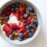 Roasted Strawberry Yogurt Breakfast Bowls with Chocolate-Coconut Granola | via forkknifeswoon.com