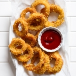 Perfectly Crispy Potato Chip Crusted Baked Onion Rings | via forkknifeswoon.com