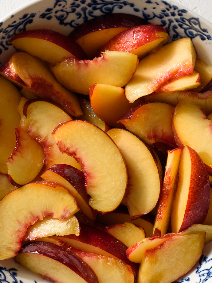sliced peaches ready to become puff pastry tarts via forkknifeswoon.com