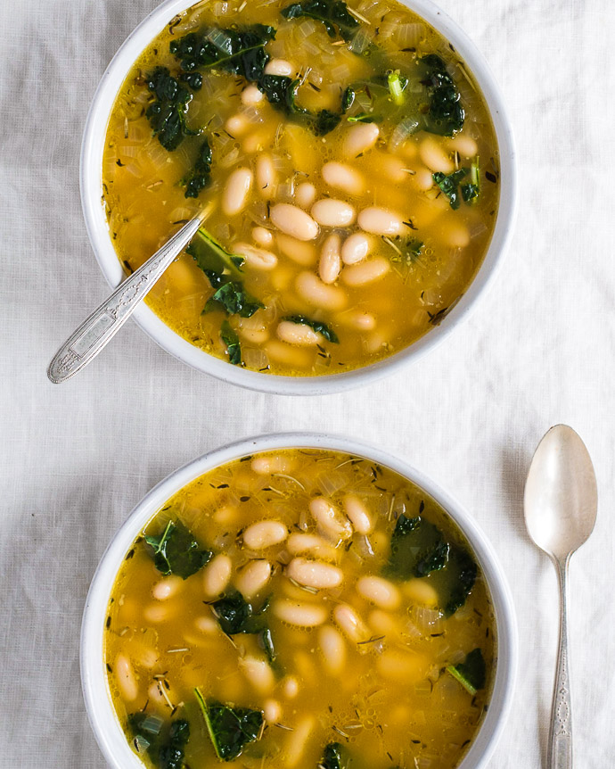 two bowls of white bean soup with kale from forkknifeswoon.com