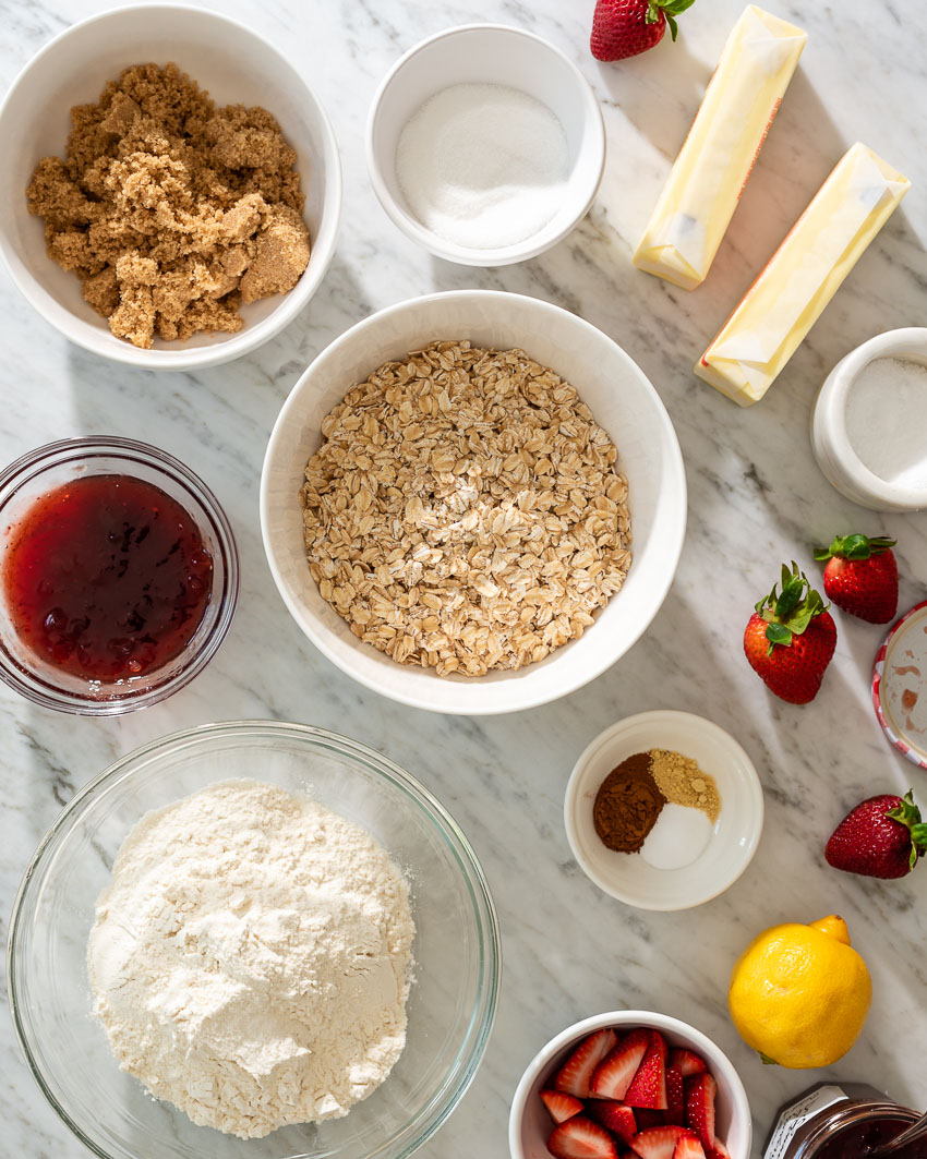 the ingredients to make strawberry jam crumble bars from forkknifeswoon.com