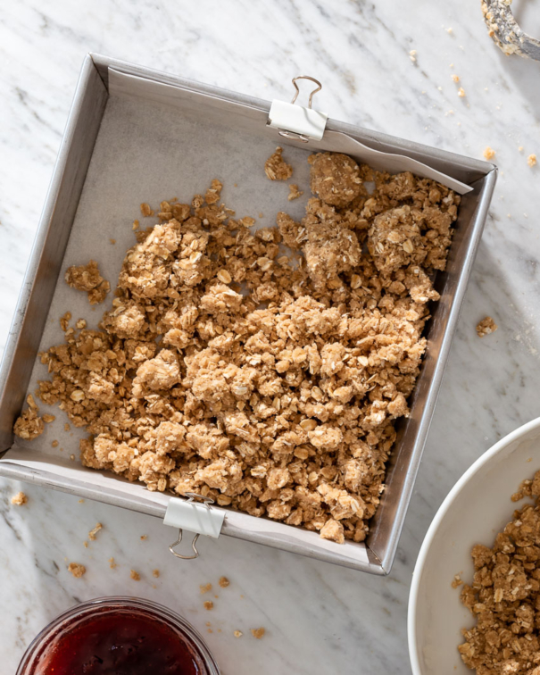 crumb topping for strawberry jam bars in a baking pan from forkknifeswoon.com