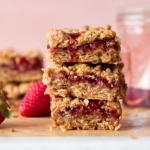 a stack of strawberry jam crumble bars from forkknifeswoon.com